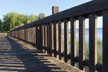 A walkway leads to a park by a large lake in Eugene, Oregon 写真素材