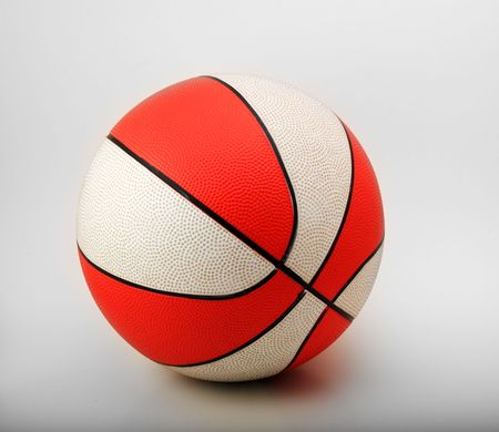 Orange and white rubber basketball on a white background. photo