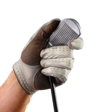 grooves: Left hand wearing a well-worn golf glove holds club by head, showing clubface and grooves, isolated on white background.