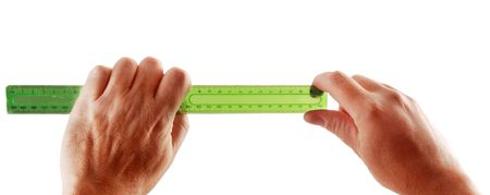 millimetre: Two hands hold a green ruler isolated with a white background.