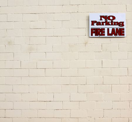 No parking fire lane sign white wall