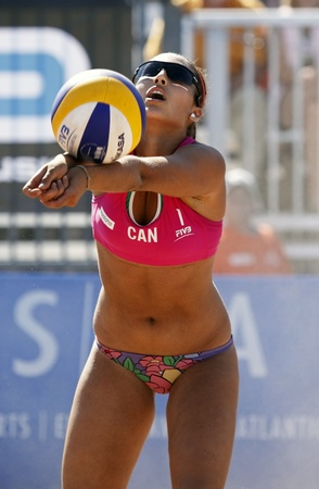 HALIFAX, CANADA - SEPTEMBER 3, 2011 - Victoria Altomare of Canada passes the ball at the FIVB Beach Volleyball Swatch Junior World Championships on Sept. 3, 2011 in Halifax, Canada.