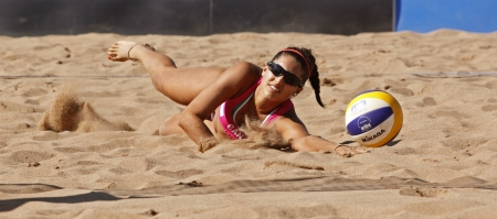 HALIFAX, CANADA - SEPTEMBER 3, 2011 - Victoria Altomare of Canada dives for the ball at the FIVB Beach Volleyball Swatch Junior World Championships on Sept. 3, 2011 in Halifax, Canada.