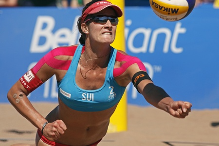 HALIFAX, CANADA - SEPTEMBER 3, 2011 - Joana Heidrich of Switzerland chases the ball at the FIVB Beach Volleyball Swatch Junior World Championships on Sept. 3, 2011 in Halifax, Canada.