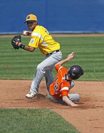 BANGOR, MAINE - AUGUST 19, 2011 - Chayce Kaaua of US West (Hilo, Hawaii) tries for a double play at the Senior League Baseball World Series semifinals against EMEA (Italy) August 19, 2011 in Bangor, Maine.