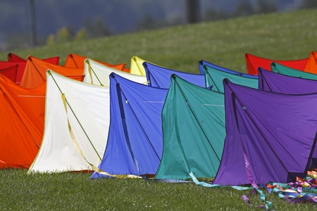await: DIEPPE, CANADA - AUGUST 14, 2011 - Kites await their flying time at the 2011 Dieppe Kite International on August 14, 2011 in Dieppe, Canada.