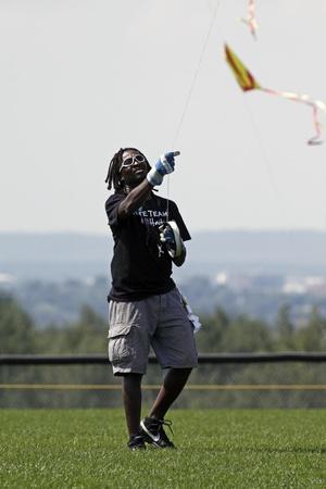 DIEPPE, CANADA - AUGUST 14, 2011 - Wadson Michel of Haiti steers his kite at the 2011 Dieppe Kite International on August 14, 2011 in Dieppe, Canada.