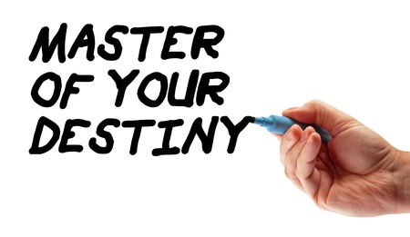 Closeup of a hand writing a message Master Of Your Destiny, possibly for a business strategy, isolated on a white background.