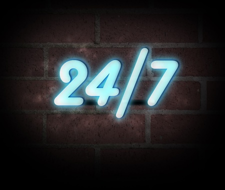 Blue neon sign on a brick wall with message 247.