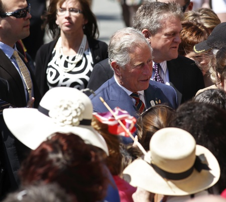 prince charles of england: Saint John, Canada - May 21 - Charles, Prince of Wales, greets the public during a walkabout on Prince William Street on May 21, 2012, in Saint John, Canada.