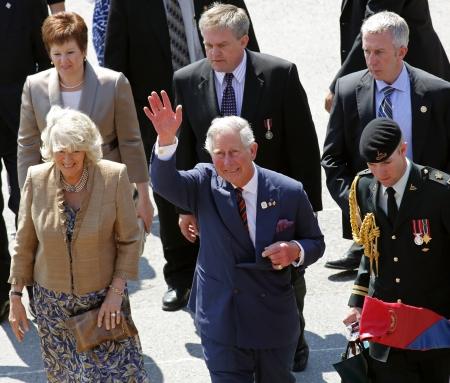 prince charles of england: Saint John, Canada - May 21 - Charles, Prince of Wales, and Camilla, Duchess of Cornwall, depart the Marco Polo cruise terminal on May 21, 2012, in Saint John, Canada.