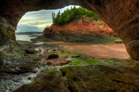HDR image of caves and coastal features at low tide of the Bay of Fundy at St. Martins, New Brunswick, Canada. Stock Photo