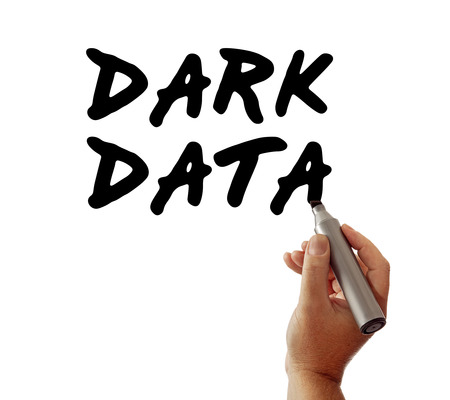 unstructured: Closeup of a hand writing the message Dark Data with a marker, possibly for a business or Internet  Web strategy, isolated on a white background. Stock Photo