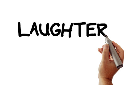 Closeup of a hand writing the word Laughter with a marker, possibly for a business or personal health strategy, isolated on a white background.