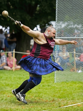 competes: FREDERICTON, CANADA - July 28: Al MacFarlane competes in the weight for distance toss at the New Brunswick Highland Games Festival July 28, 2013 in Fredericton, Canada.