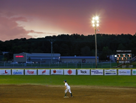 SHERBROOKE, CANADA - August 4: The sun sets on a women's softball game at the Canada Games August 4, 2013 in Sherbrooke, Canada.