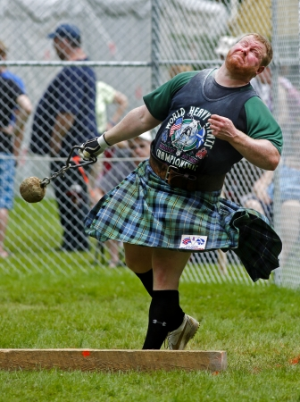 hammer throw: FREDERICTON, CANADA - July 28: Greg Hadley competes in the weight for distance toss at the New Brunswick Highland Games Festival July 28, 2013 in Fredericton, Canada. Editorial