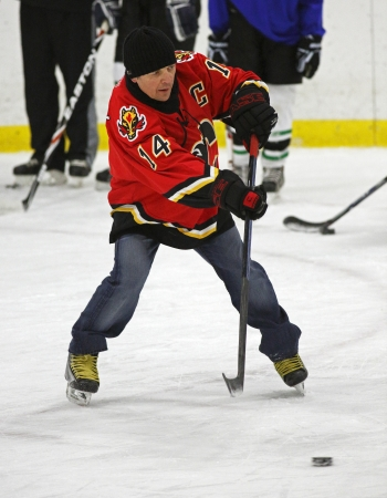 richer: Former National Hockey League star Theo Fleury gives passing instruction at a hockey clinic in Sussex, New Brunswick, Canada, on Dec. 10, 2013. Fleury was in the province as part of an NHL Legends tour.