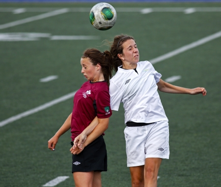 SHERBROOKE, CANADA - August 7: Brenna Kettlewell of New Brunswick and Danielle Younker of Prince Edward Island compete in women's soccer at the Canada Games August 7, 2013 in Sherbrooke, Canada.