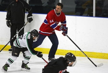 richer: Former National Hockey League star Stephane Richer skates with youngsters at a hockey clinic in Sussex, New Brunswick, Canada, on Dec. 10, 2013. Richer was in the province as part of an NHL Legends tour.
