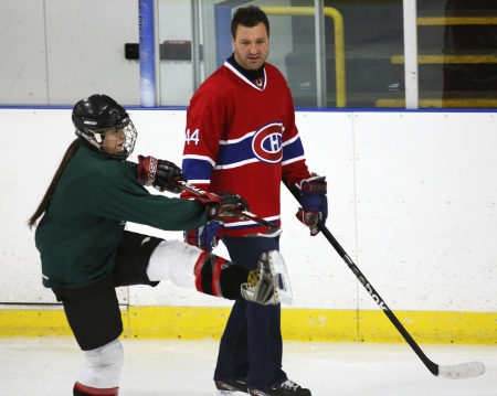 instructs: Former National Hockey League star Stephane Richer instructs at a hockey clinic in Sussex, New Brunswick, Canada, on Dec. 10, 2013. Richer was in the province as part of an NHL Legends tour. Editorial
