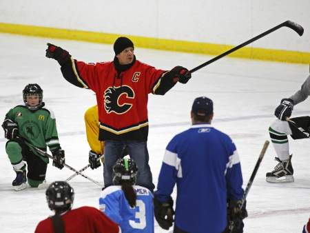 richer: Former National Hockey League star Theo Fleury instructs at a hockey clinic in Sussex, New Brunswick, Canada, on Dec. 10, 2013. Fleury was in the province as part of an NHL Legends tour.