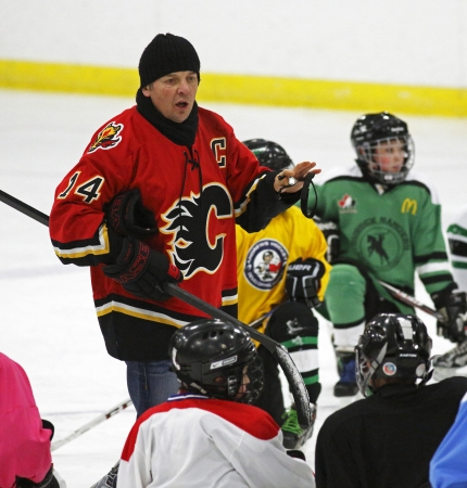 instructs: Former National Hockey League star Theo Fleury instructs at a hockey clinic in Sussex, New Brunswick, Canada, on Dec. 10, 2013. Fleury was in the province as part of an NHL Legends tour.