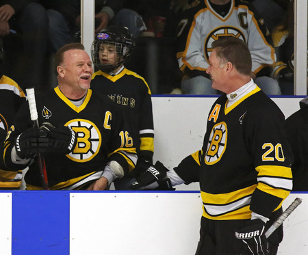 middleton: Former NHL stars Rick Middleton and Bob Sweeney share a laugh at a Boston Bruins alumni hockey game March 20, 2014 in Sussex, Canada.