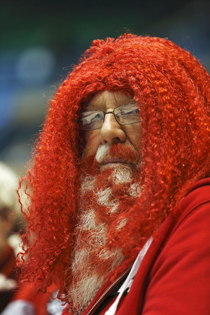 SAINT JOHN, CANADA - March 19: A Canadian fan wears his team's colors on his beard and hair at the Ford World Women's Curling Championship March 19, 2014 in Saint John, Canada.