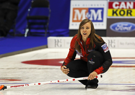 instructs: SAINT JOHN, CANADA - March 19: Skip Rachel Homan of Canada instructs her sweepers at the Ford World Womens Curling Championship March 19, 2014 in Saint John, Canada.