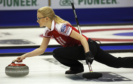 SAINT JOHN, CANADA - March 19: Russia's Alexandra Saitova delivers a stone at the Ford World Women's Curling Championship March 19, 2014 in Saint John, Canada.