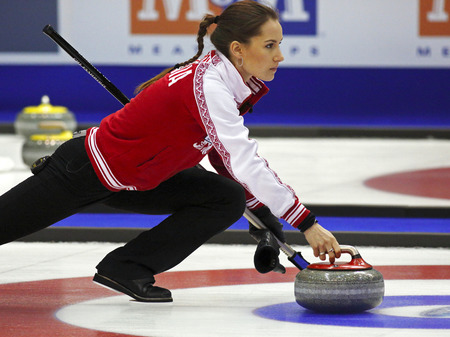 delivers: SAINT JOHN, CANADA - March 19: Anna Sidorova of Russia delivers her rock at the Ford World Womens Curling Championship March 19, 2014 in Saint John, Canada.
