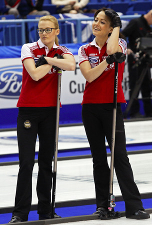 SAINT JOHN, CANADA - March 19: Team Russia's front end of Alexandra Saitova and Ekaterina Galkina at the Ford World Women's Curling Championship March 19, 2014 in Saint John, Canada.