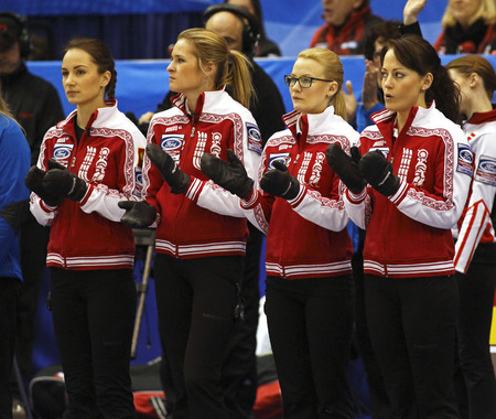 SAINT JOHN, CANADA - March 19: Russia's Anna Sidorova, Margarita Fomina, Alexandra Saitova and Ekaterina Galkina at the Ford World Women's Curling Championship March 19, 2014 in Saint John, Canada.