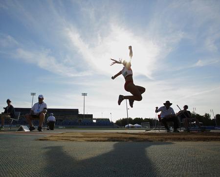 salto largo: Divyajyoti Biswal compite en salto de longitud de la mujer en el Canadian Pista Campeonato de Campo 28 de junio 2014 en Moncton, Canad�.