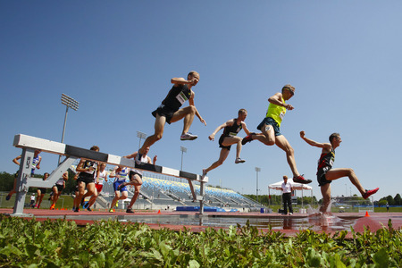 steeplechase: Competitors in the mens 3000-meter steeplechase at the Canadian Track  Field Championships June 28, 2014 in Moncton, Canada. Chris Winter top, Christopher Dulhanty, Matthew Hughes 9 and Taylor Milne 3.
