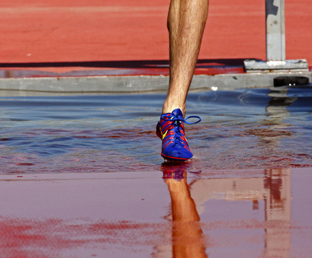 steeplechase: Touching down in the water in the mens 3000-metre steeplechase at the Canadian Track  Field Championships June 28, 2014 in Moncton, Canada.