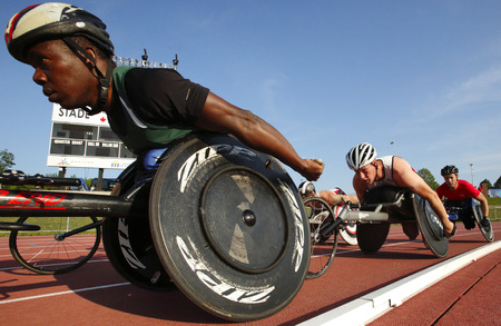 competes: Basile Niamba Soulama left competes in the mens 1500-metre wheelchair at the Canadian Track  Field Championships June 28, 2014 in Moncton, Canada. Editorial