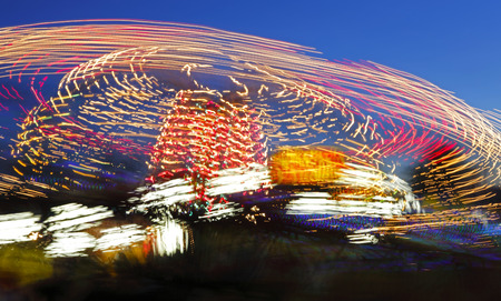 midway: Handheld long exposure of a fair ride at night.