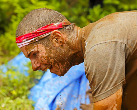 concentrates: Mike Roth concentrates at the Mud Run for Heart July 25, 2015, Waterford, New Brunswick, Canada.