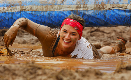 Alexandra Sorensen moves through the mud and water at the Mud Run for Heart July 25, 2015, Waterford, New Brunswick, Canada.