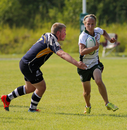 canadian football: Owen Reist of New Brunswick rushes against Nova Scotia at the Eastern Canadian Rugby Championships July 10, 2015 in Belleisle, Canada. Editorial
