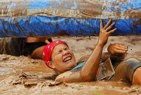 Melissa Gardner tackles a tricky area at the Mud Run for Heart July 25, 2015, Waterford, New Brunswick, Canada. Editorial