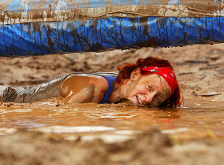 Wendy Fleming gets a water level view at the Mud Run for Heart July 25, 2015, Waterford, New Brunswick, Canada.