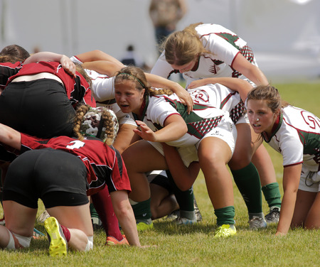 A scrum between New Brunswick and Newfoundland women at the Eastern Canadian Rugby Championships July 10, 2015 in Belleisle, Canada. Editorial