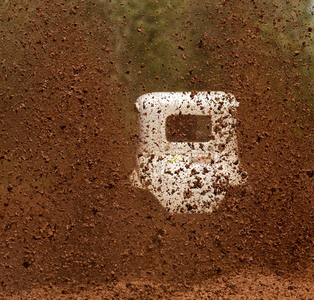 Dirt sprays from the back of a truck at a mud bog. Focus on the dirt.