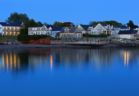the bay: Twilight reflections of buildings and lights on waterfront at Saint Andrews, New Brunswick, Canada.