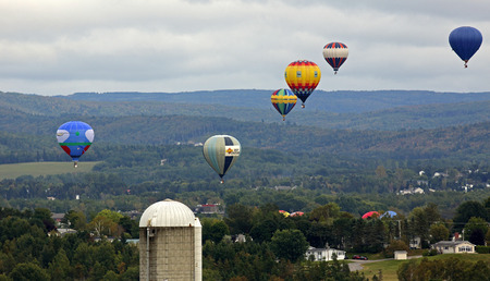Evening flight at the 30th annual Atlantic International Balloon Fiesta over Sussex, New Brunswick, Canada, Sept. 13, 2015.