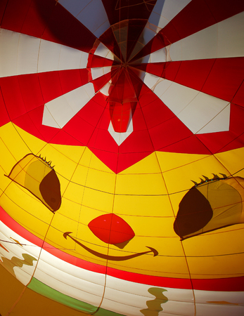 A smiling face inside a hot air balloon as it inflates at the 30th annual Atlantic International Balloon Fiesta in Sussex, New Brunswick, Canada, Sept. 12, 2015.