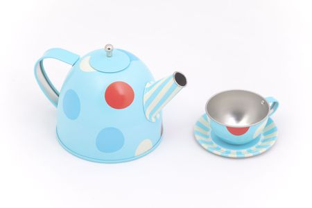 party time: Childs toy teapot and cup against a white background